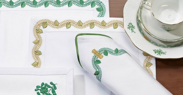 white set with golden and green floral embroidery